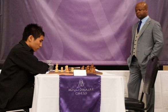 Grandmaster Wesley So ponders his moves as organizer Maurice Ashley looks on in the opener of the Millionaire chess tournament at the Planet Hollywood  Resort & Casino.