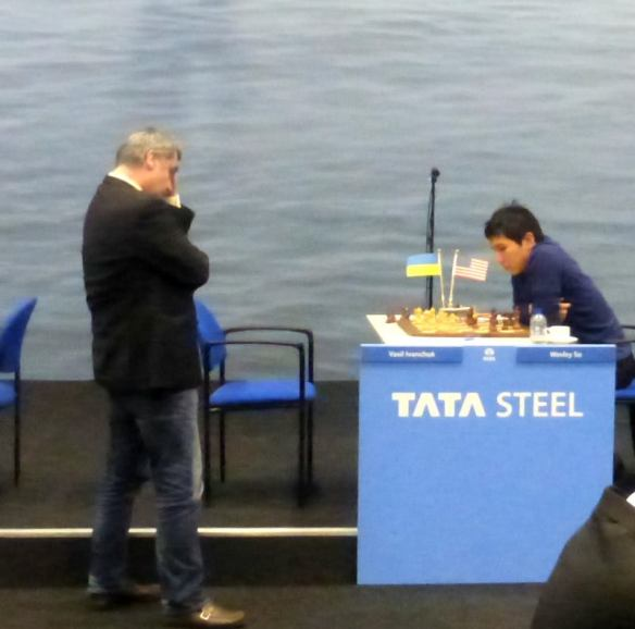 Grandmaster Vassily Ivanchuk (standing) and Wesley So in the eighth round of the Tata Steel chess tournament in the Netherlands.