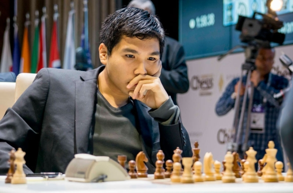 Wesley So analyzes his losing game in the seventh round of the Gashimov Memorial chess championships in Azerbaijan. PHOTO BY SHAMKIR CHESS 2015.