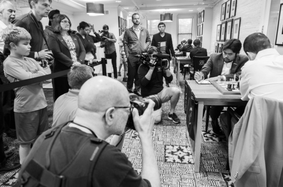 Wesley So is an interested spectator in the game between Hikaru Nakamura and Elexander Onischuck in the US Chess Championships. Nakamura captured the championship. PHOTO BY LENNART OOTES.