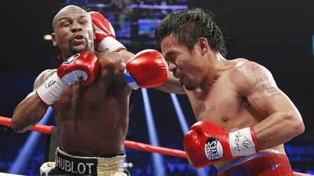 Floyd Mayweather Jr. and Manny Pacquiao exchange blows during their fight Saturday at the MGM Grand in Last Vegas