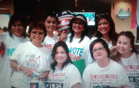 Rozita Lee (front row, standing) and her volunteers register voters at the Seafood City in Las Vegas. PHOTO BY ROZITA LEE.